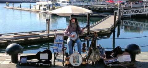 Renowned Victoria busker Dave Harris, a Causeway regular